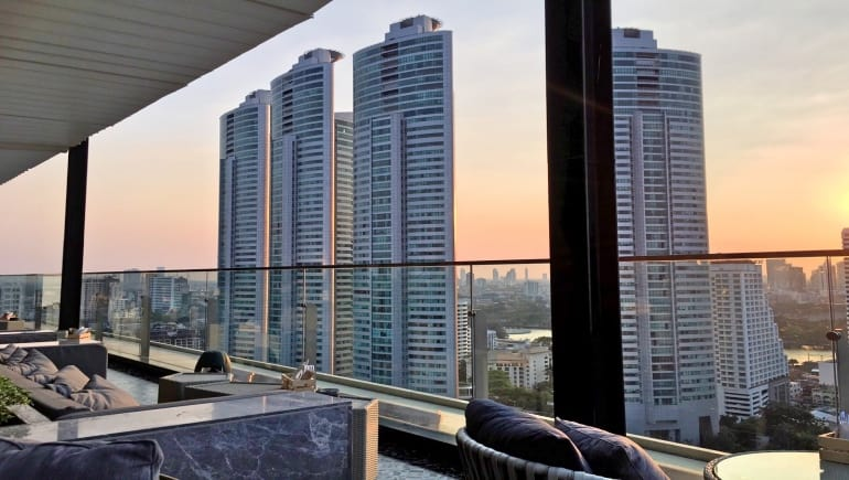 When was the four towers at Millennium Residence in Bangkok built and completed?